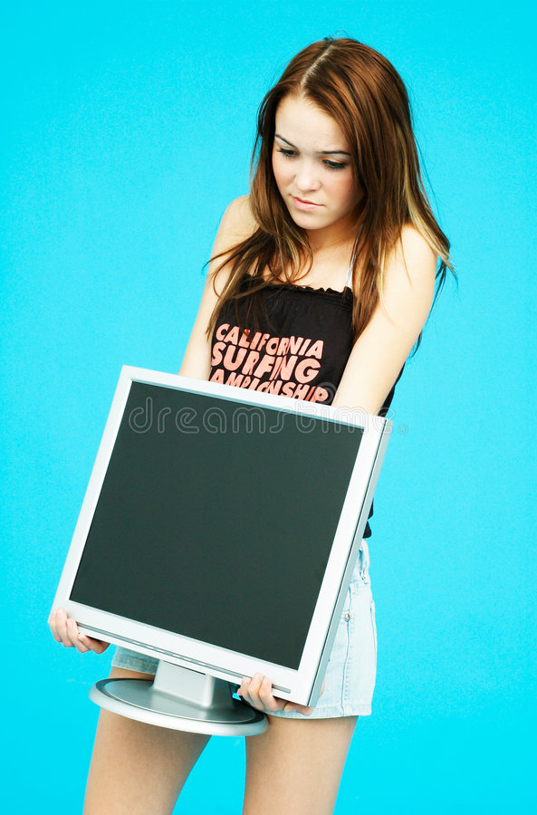 Download Big monitor - small girl. stock photo. Image of content - 1446562