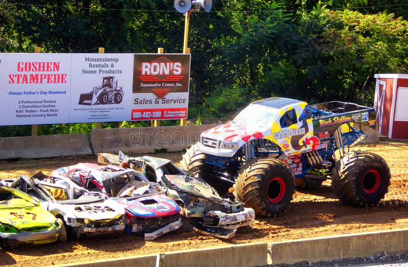 Monster trucks show. A big monster truck crushing cars in 105th annual goshen fair in torrington connecticut united states royalty free stock photography