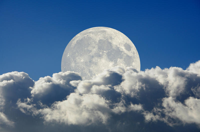 Big moon and clouds stock photography