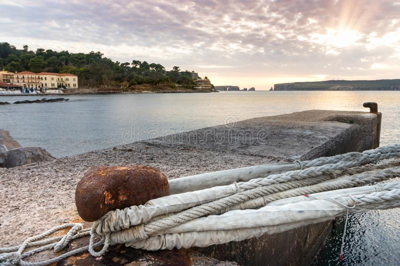 A big mooring line of a cruise ship on a bolland the the port of Pylos, Greece royalty free stock image
