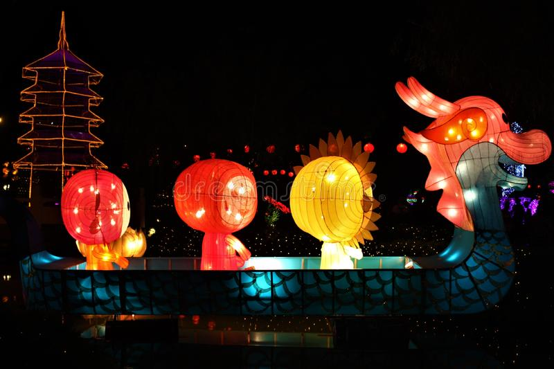 Big  multicolour paper lanterns  floating on water at night royalty free stock photos