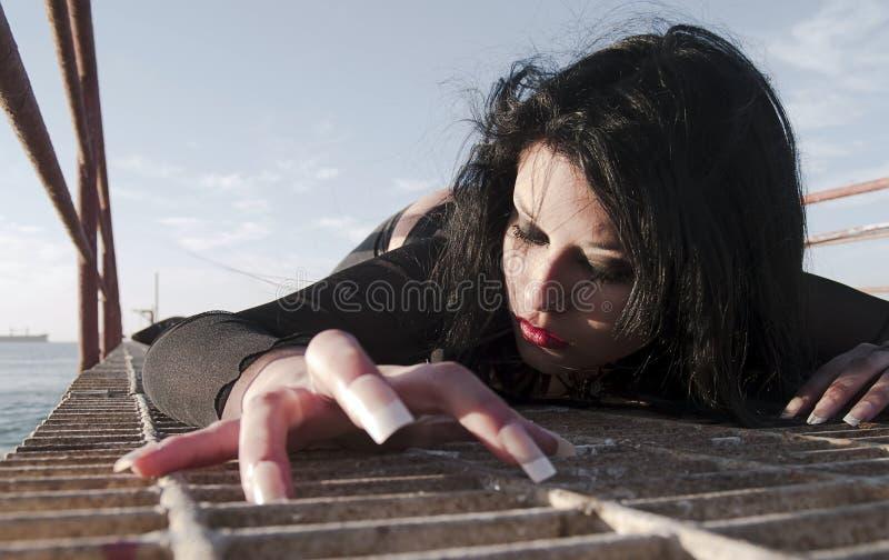 Big nails woman. Gothic young woman posing outdoors at the seacoast of Valparaiso stock photo