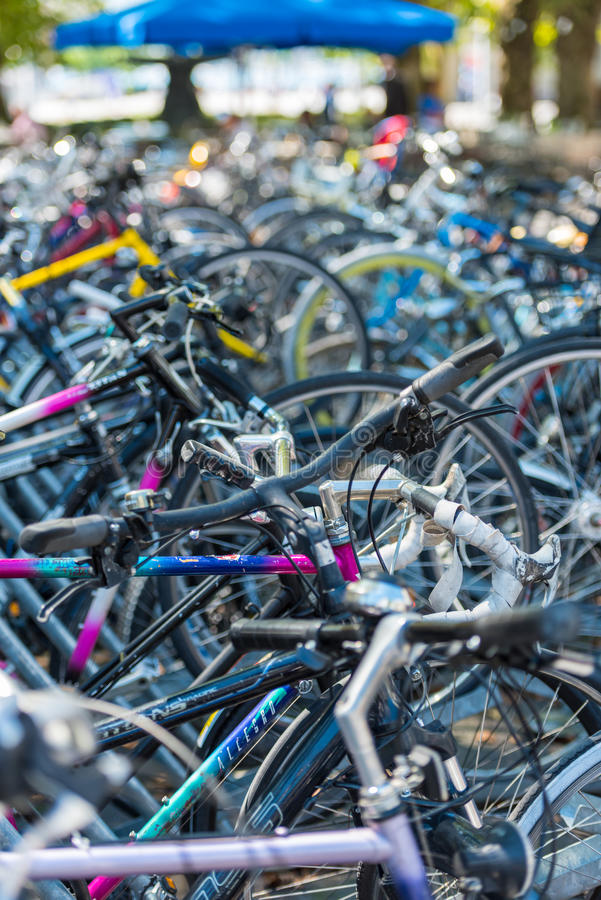 The big number of City Bicycles on a parking. SWITZERLAND, ZURICH - AUGUST 22: The big number of City Bicycles on a parking on August 22, 2015. Small GRIP stock image