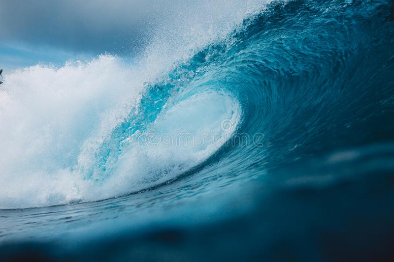 Big ocean blue wave. Breaking barrel wave royalty free stock photos