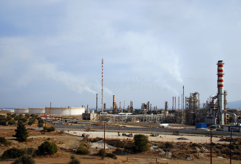 Big oil refinery at dusk. Pollution over big oil refinery at dusk stock image