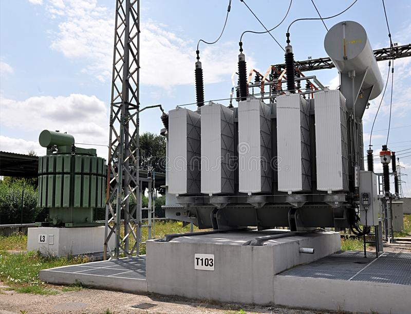 Big oil transformers. Modern big oil transformers in day stock images