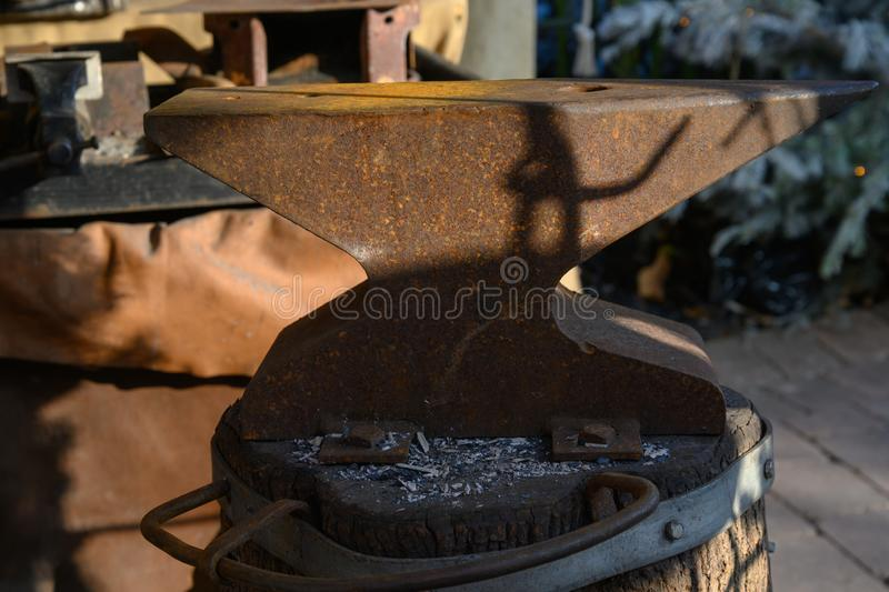 Big old anvil on a tree stump stock images