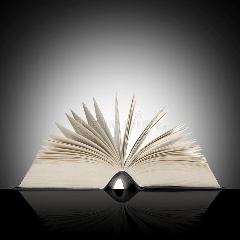 Big open book on dark background. Big open book on shaded background royalty free stock images