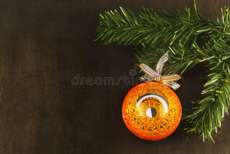 Big orange mirror ball on xmas tree, black background. royalty free stock images