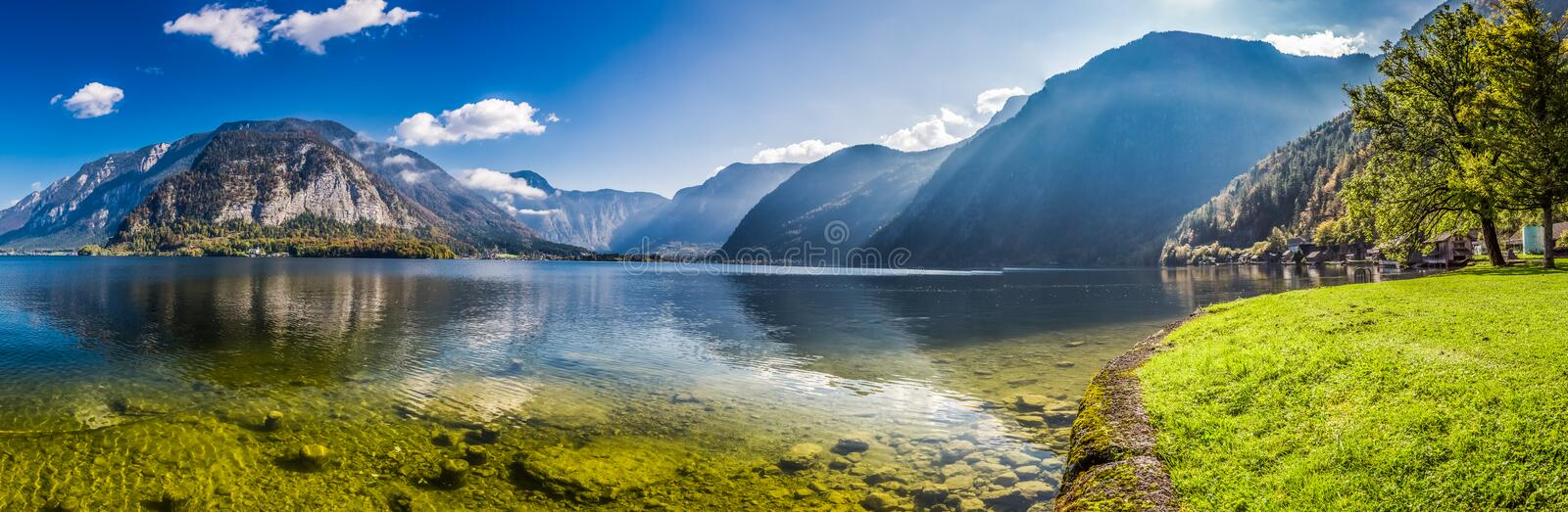 Big panorama of crystal clear mountain lake in Alps royalty free stock photo