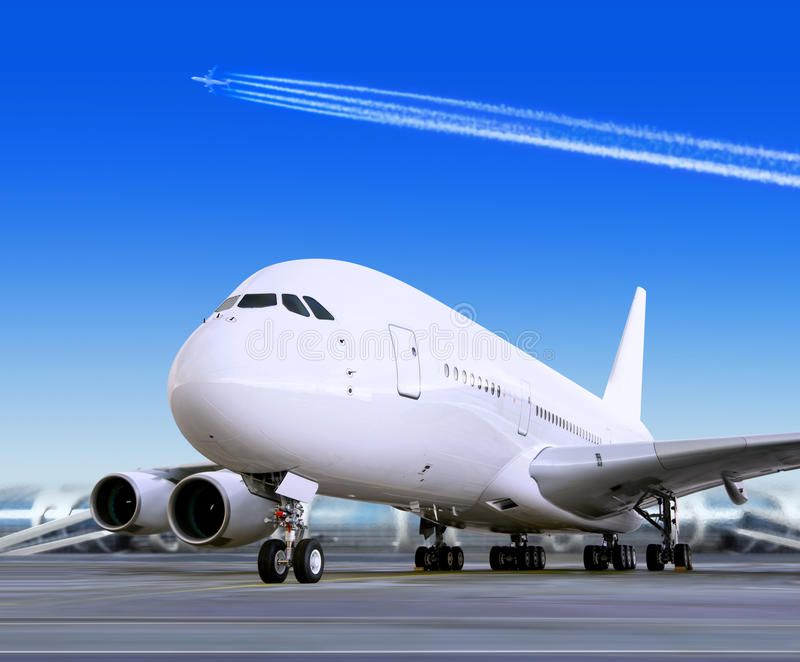 Big passenger airplane in airport. Big passenger airplane is landing to runway of airport royalty free stock image