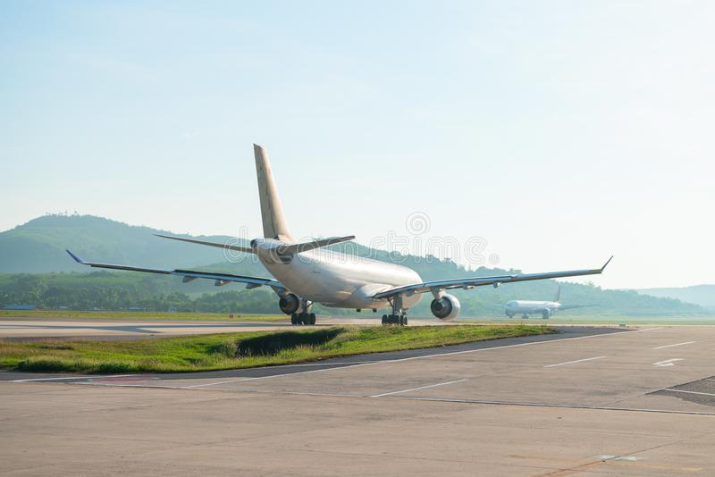 Big passenger airplanes on runway strip. Are taxiing for take-off stock photo