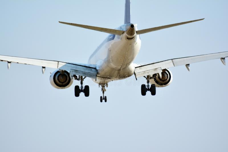 Big passenger plane is flying up from runway of airport stock image