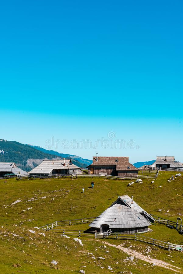 Big Pasture Plateau or Velika Planina in Slovenia. traditional Wooden Shepherd Shelters in Mountains. Agriculture, alpine, alps, architecture, balkan stock photography