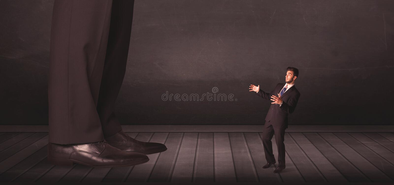 Big person with small businessman concept. On background stock photos
