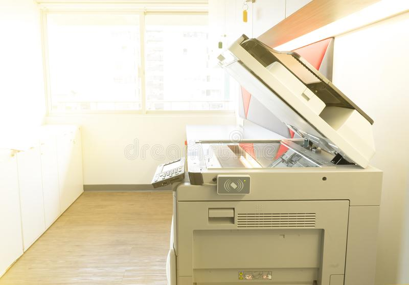 A photocopier machine and full access control of key card scanning panel in office. A big photocopier machine with full access control of key card scanning stock photo