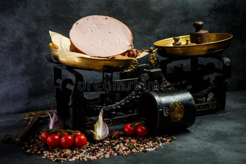 big piece of appetizing boiled sausage on craft paper stock photography