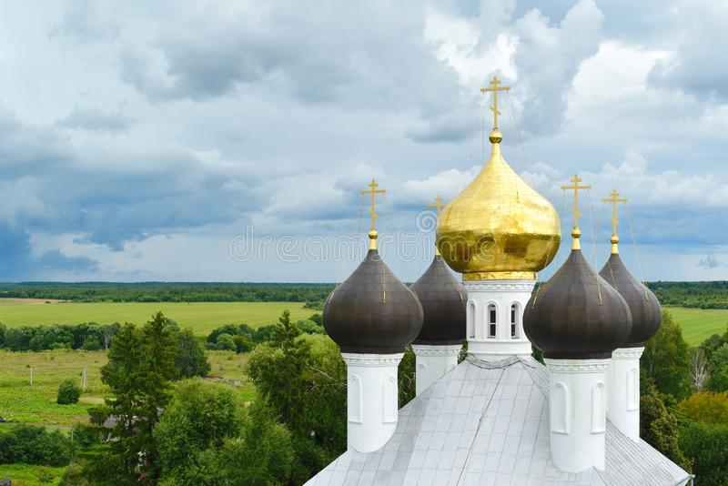 Big bell tower and domes in Russian Orthodox Church stock images
