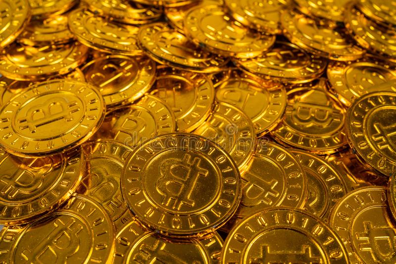 Big pile of Bitcoin coins. A big pile of Bitcoin coins stacked on each other to symbolize the virtual Bitcoin stock photo