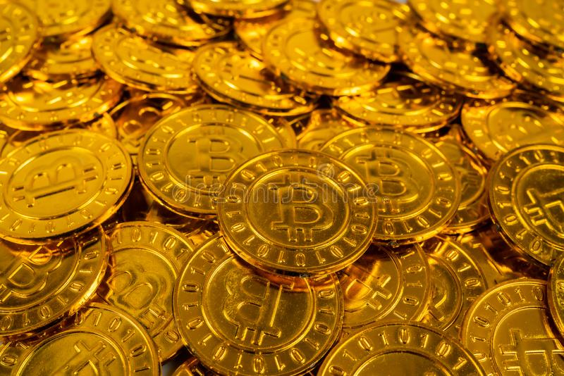 Big pile of Bitcoin coins. A big pile of Bitcoin coins stacked on each other to symbolize the virtual Bitcoin stock photography
