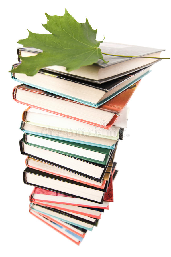 Big pile of books isolated. On white royalty free stock photo