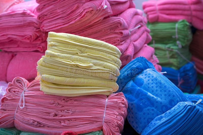 Big pile of colorful towels at production place royalty free stock image