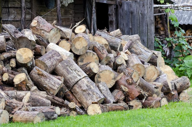 Big pile of conifers firewood. In the yard royalty free stock photos