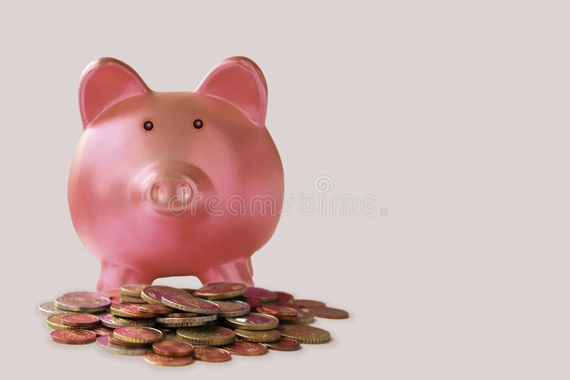 Big pile of EU coins in bulk and pink big piggy piggy bank with place for your text stock images