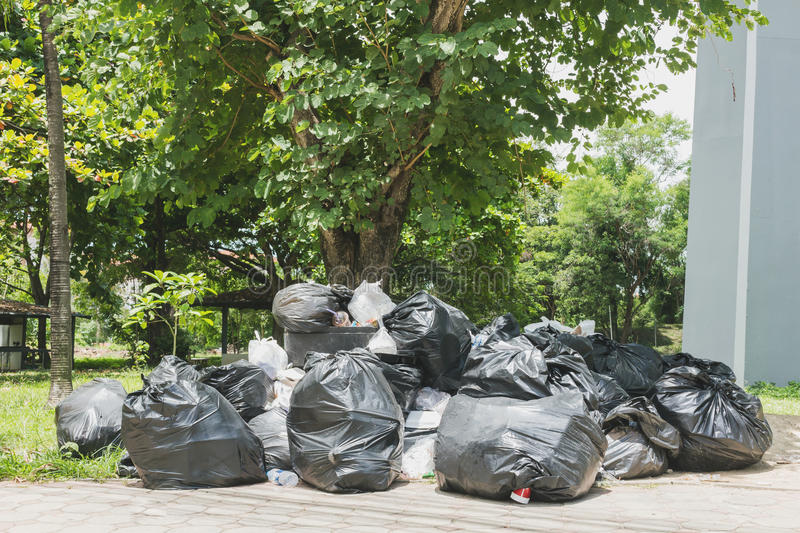 Big pile of garbage and waiste. In black bags stock image