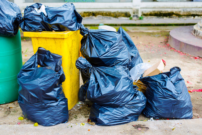 Big pile of garbage. And waste in black bags stock image