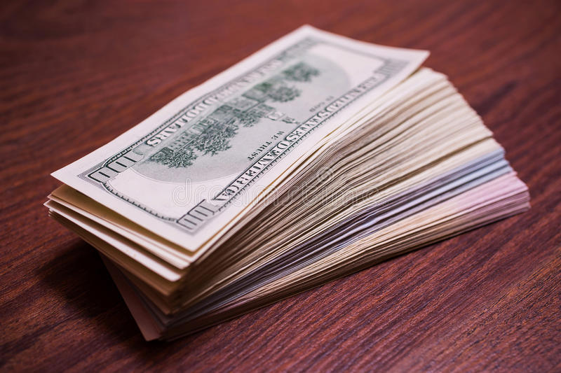 Big pile of money. Stack of money. related to money, money on the wooden background royalty free stock photography