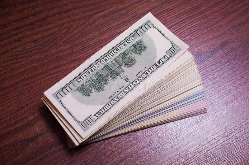 Big pile of money. Stack of money. related to money, money on the wooden background royalty free stock images