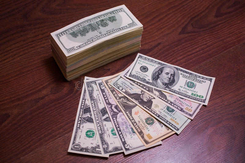 Big pile of money. Stack of money. related to money, money on the wooden background stock photos