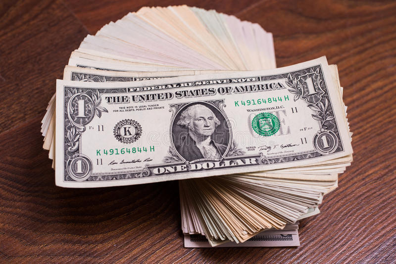 Big pile of money. Stack of money. related to money, money on the wooden background, one dollar bill face royalty free stock image