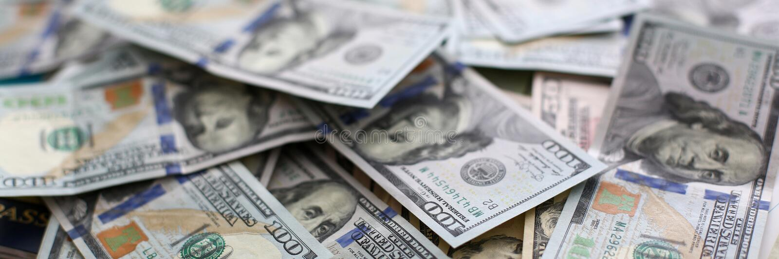 Big pile of US money lying down in random order. Closeup royalty free stock photography