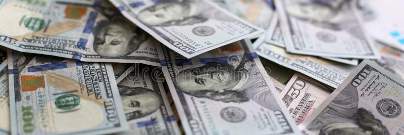 Big pile of US money lying down in random order. Closeup stock images