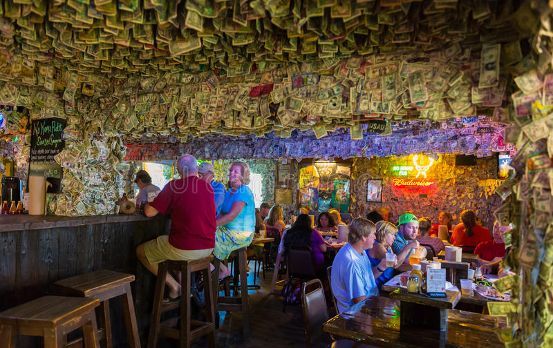 Patrons in No Name Pub. BIG PINE KEY, FL - CIRCA 2012: Patrons on famous No Name Pub circa 2012. The pub is a landmark in the Florida Keys, a popular tourist royalty free stock photography