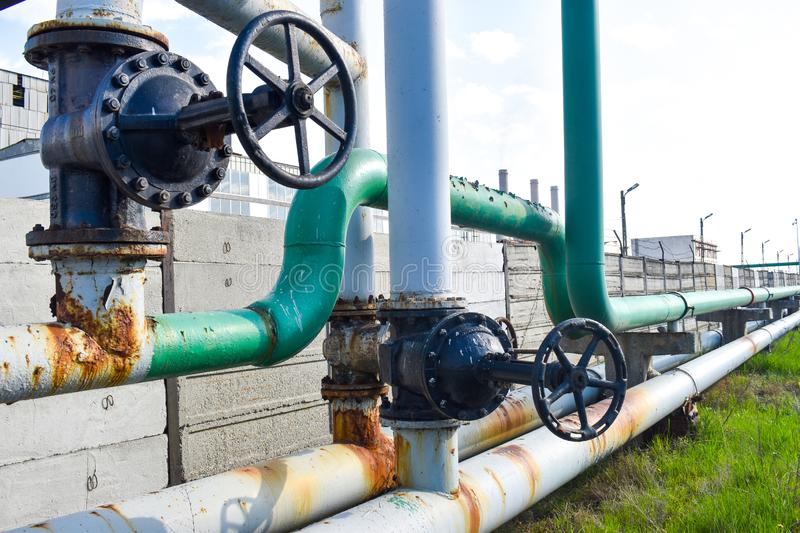 Big pipe tap on gas pipes network. Big pipe tap on the gas pipes network near the chemical plant stock photography