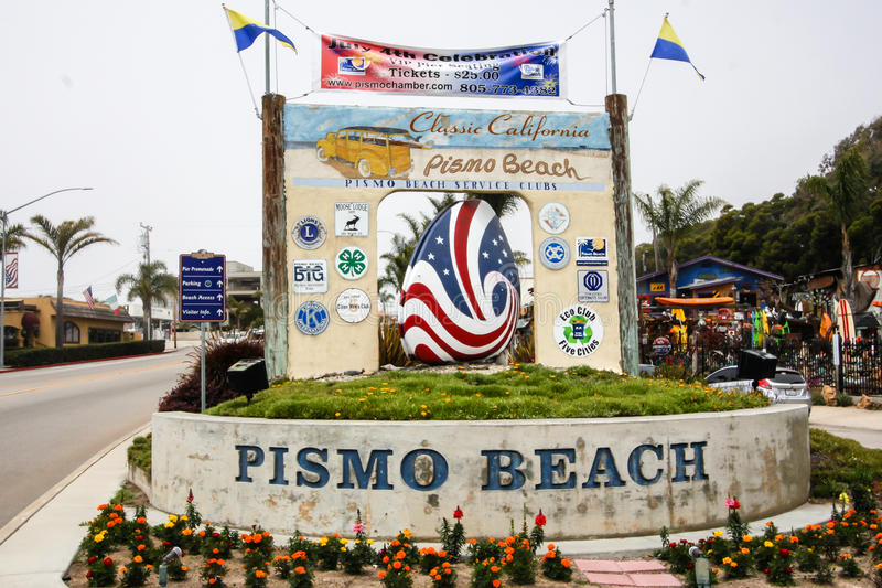 Big Pismo Beach sign in California. Concrete sign at the entrance of Pismo Beach that includes a giant concrete shell painted red, white, and blue for the royalty free stock photos