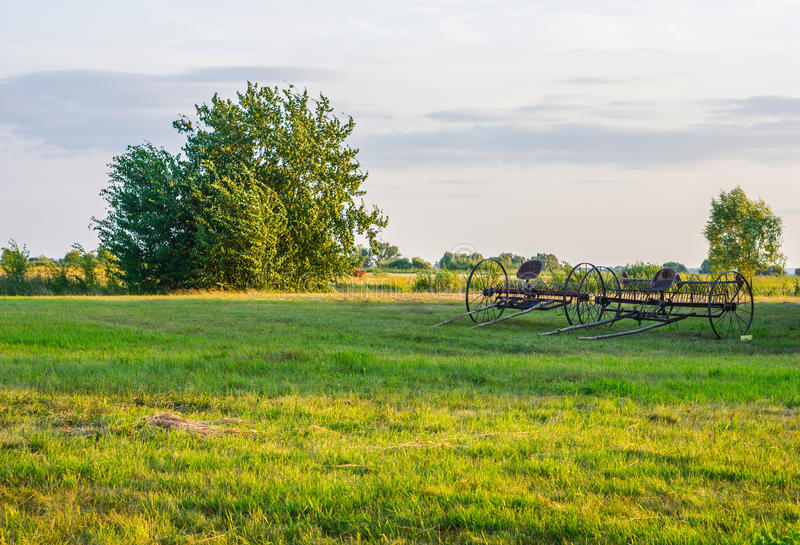 Big plough at the field royalty free stock photos