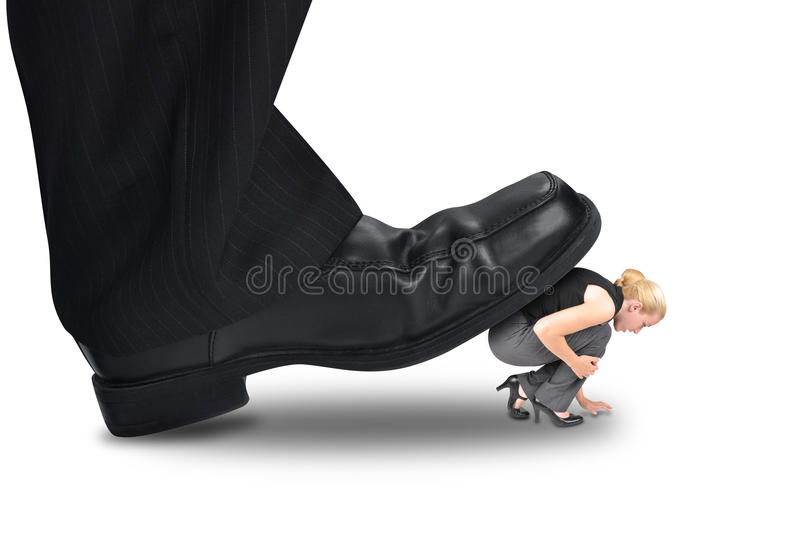 Big Power Boss Stepping on Little Employee. A big corporate foot is stepping on a small woman employee for a power or management concept stock photography