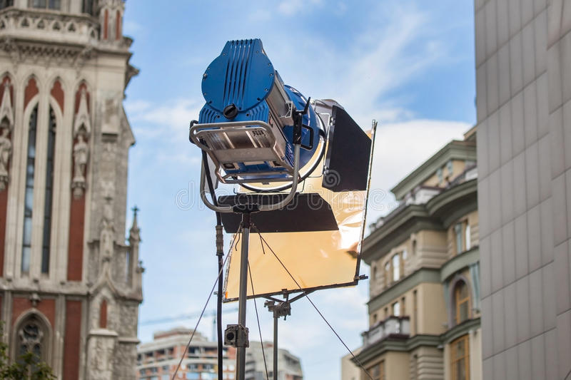 Big professional bright spotlight with color filter on a tripod stock photo