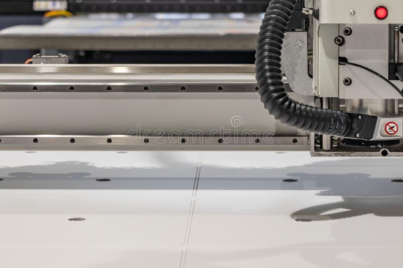 Big professional cnc plotter, processing a large scale set of foam panels for exhibition project. Moving print head in motion with blur stock images