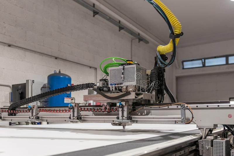 Big professional cnc plotter, processing a large scale set of foam panels for exhibition project. Moving print head in motion with blur stock image