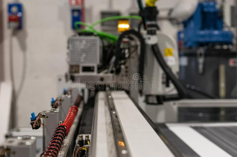 Big professional cnc plotter, processing a large scale set of foam panels for exhibition project. Moving print head in motion with blur stock photography