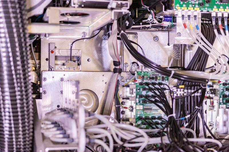 Big professional printer, detailed shot of the motherboard and the wiring system. Appearing as a time bomb royalty free stock photography