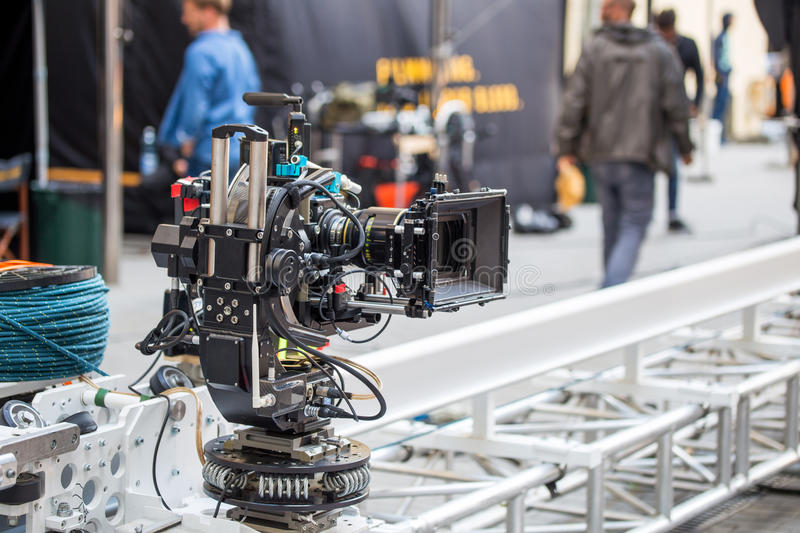 Big professional video camera. Moving on a rails on a movie set stock images