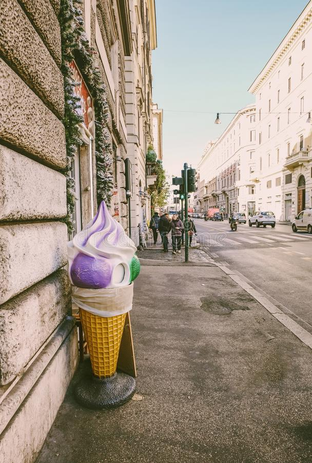 Big purple and green ice cream cone on the streets of Rome royalty free stock photography