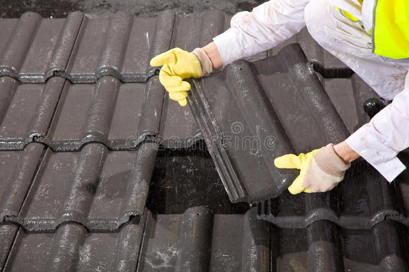 Worker on roof fixing roof tiles stock photo image of plywood download worker on roof fixing roof tiles stock photo image of plywood construct ppazfo
