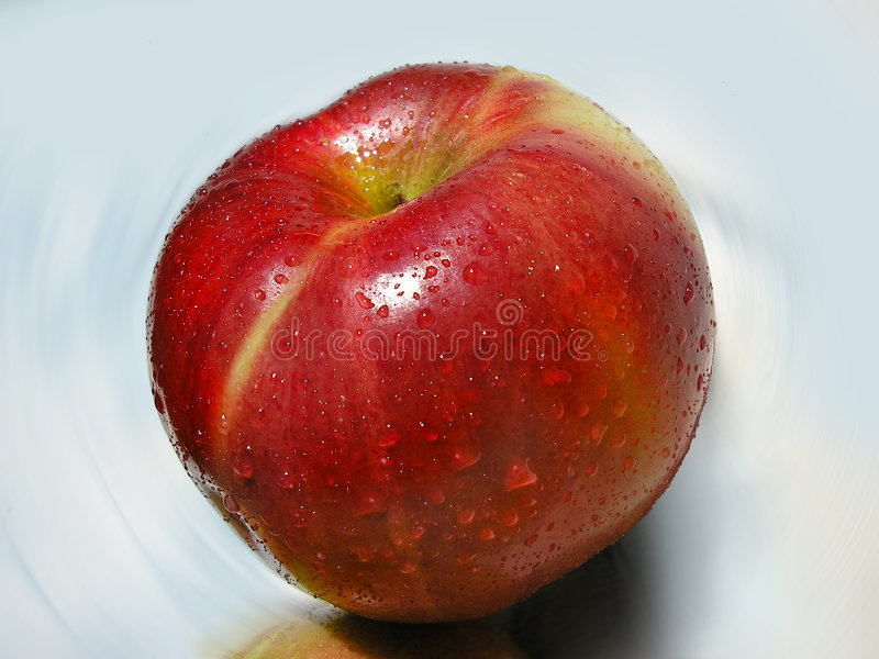 Big Red Apple With Dew royalty free stock photos
